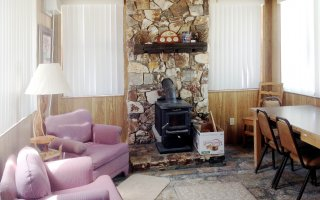 Cabin Living Room has Woodstove