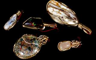 There's a precious black opal in the center, and the one below that shows pinfire in the matrix