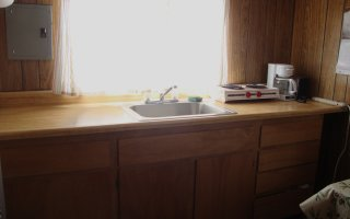 The Trailer has a kitchen counter and sink